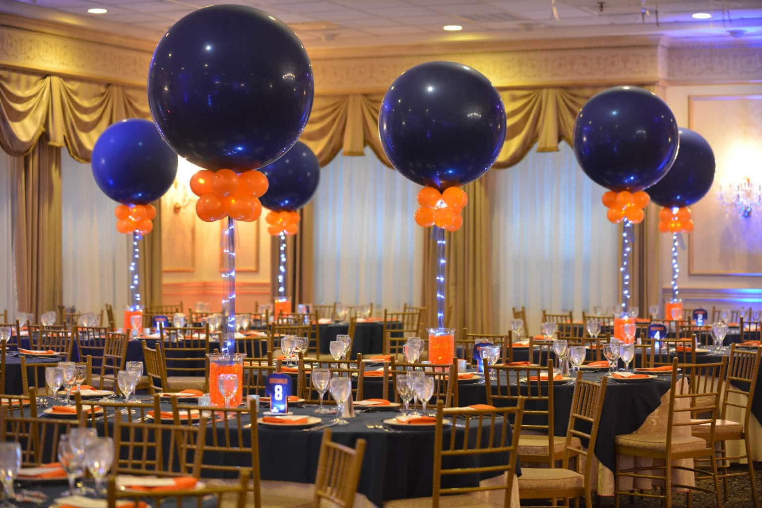 Aqua gems centerpieces balloon artistry for Orange centerpieces for tables