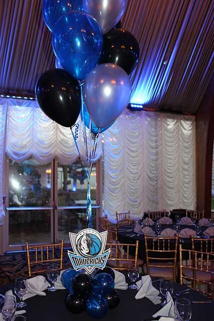 blue black silver balloon centerpiece with balloon base and logo cutouts