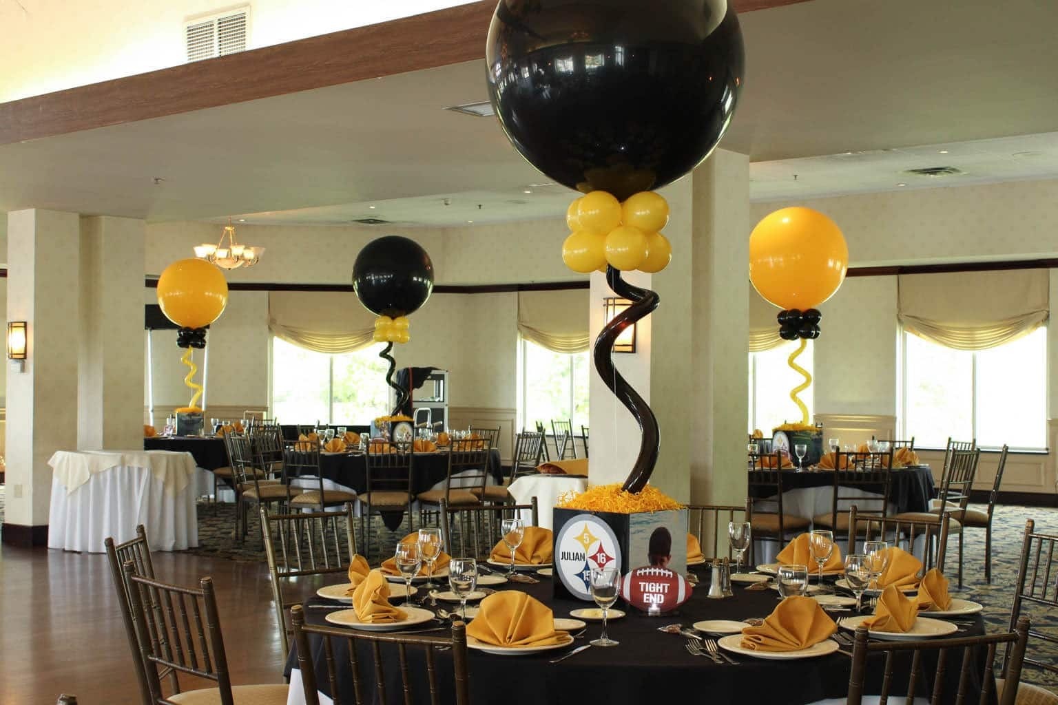 ... Centerpieces and Alternating Navy & Gold Sparkle Balloons at Seasons
